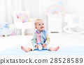 Baby boy with bottle drinking milk or formula 28528589