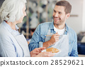 Positive aged woman and her grandson baking 28529621
