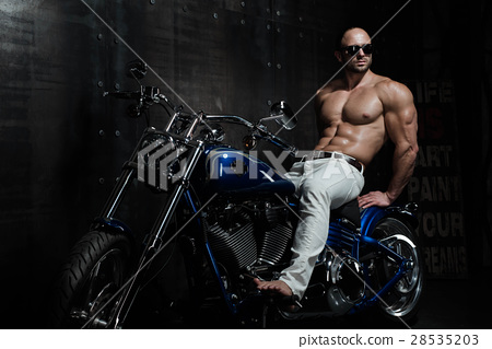 Hot sexy handsome young bodybuilder on a motorbike 28535203