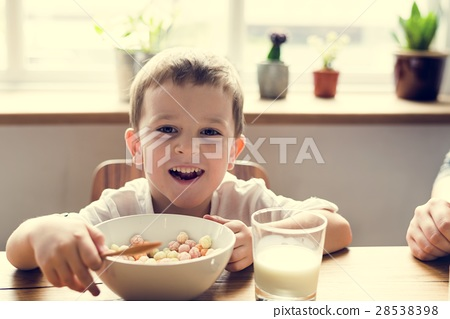 Little Boy Enjoying Bowl Of Cereal 28538398