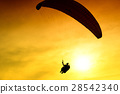 Silhouette of parachute on sunset 28542340