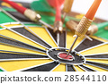 darts arrows in the target center 28544110