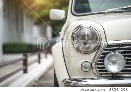 Classic car with close-up on headlights 28544298