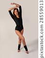 Beautiful girl in black gymnastic suit 28559013