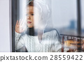 child baby pilot at window with toy airplane. 28559422
