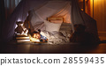 child girl sleeping in tent with  book and flashlight 28559435