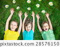 Group of happy children playing outdoors 28576150