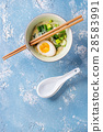 Asian soup with eggs, onion and spinach 28583991