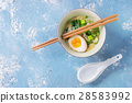 Asian soup with eggs, onion and spinach 28583992