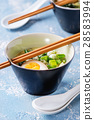 Asian soup with eggs, onion and spinach 28583994