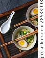 Asian soup with eggs, onion and spinach 28583998