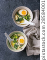 Asian soup with eggs, onion and spinach 28584001