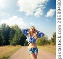 Street Style Woman in Eyewear Looking Up 28589480