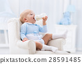 Baby boy with bottle drinking milk or formula 28591485