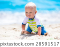 Baby boy on tropical beach 28591517