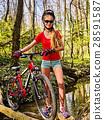Bicycle teen with ladies bikes in summer park 28591587