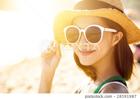 young woman enjoy summer vacation on the beach 28591987