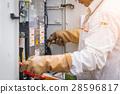 engineer working on checking and maintenance equipment 28596817
