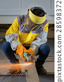 Worker work hard with the Electric wheel grinding 28598372
