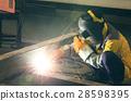 worker spark welding 28598395