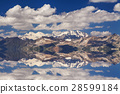 Reflection of snow-capped mountains with clouds 28599184
