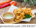 Fried squid rings with green hot spicy sauce 28599267