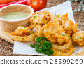 Fried squid rings with green hot spicy sauce 28599269
