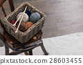 scissors and yarn inside old basket wooden chair 28603455