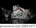 Wedding Rings Sinking in Water, Black Background 28603477