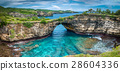 Stone arch over the sea. Broken beach, Nusa Penida 28604336