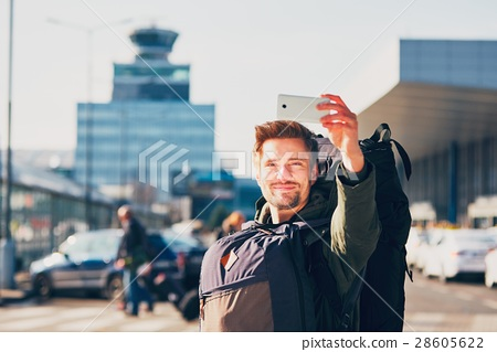 Traveler taking a selfie at the airport 28605622