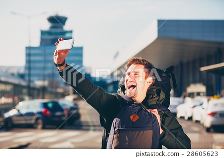 Traveler taking a selfie at the airport 28605623