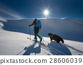 Girl makes ski mountaineering with his dog 28606039