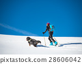 Girl makes ski mountaineering with his dog 28606042