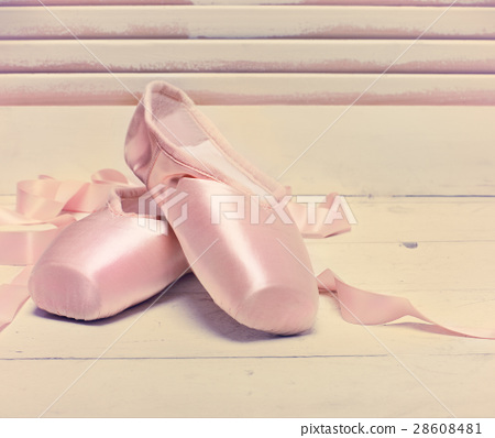Pair of a pale pink ballet point shoes 28608481