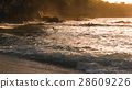 Local Kids surf on Waves in Sunset light 28609226