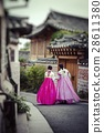 A couple women wander through the traditional styl 28611380