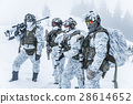 Squad of soldiers in winter forest 28614652