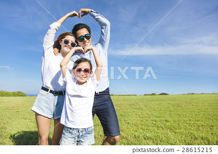 Happy playful young  family forming love shape 28615215