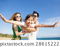 Happy young Family Having Fun at the Beach 28615222
