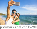 young couple  taking vacation selfie photograph  28615299