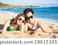 Happy young Couple  having fun on the Beach 28615305