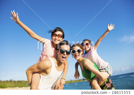 Happy Family Having Fun at the Beach 28615355