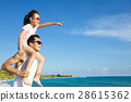father and Daughter having fun on the beach 28615362