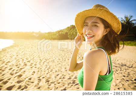 young woman enjoy summer vacation on the beach 28615385