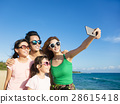 happy family taking a selfie at the beach 28615418