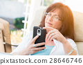 Attractive Middle Aged Woman Using Her Smart Phone 28646746