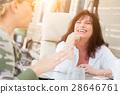 Two Female Friends Enjoying Conversation Outside 28646761