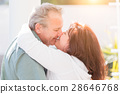 Middle Aged Couple Enjoy A Romantic Slow Dance and Kiss Outside 28646768