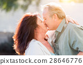 Middle Aged Couple Enjoy A Romantic Slow Dance and Kiss Outside 28646776